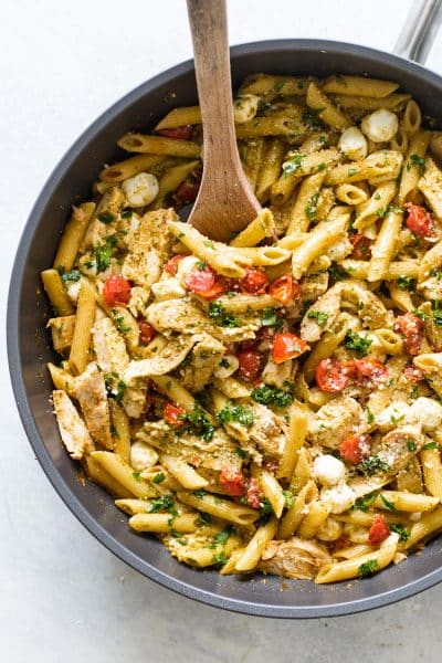 overhead photo of pesto chicken pasta in a skillet
