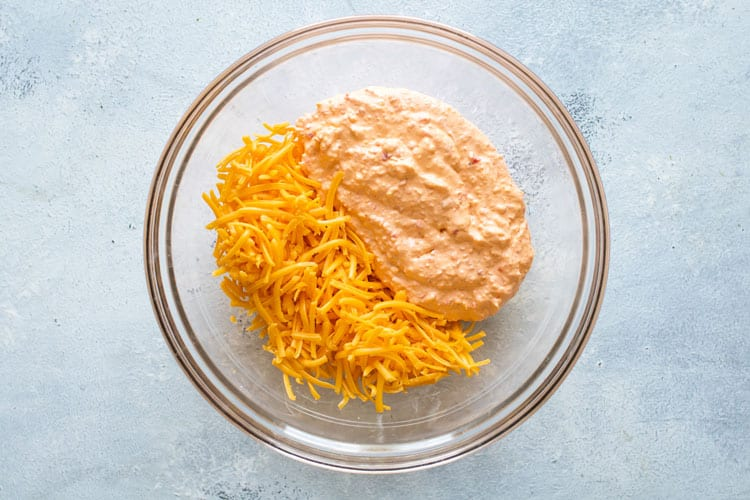 overhead photo showing how to stir in the shredded cheese
