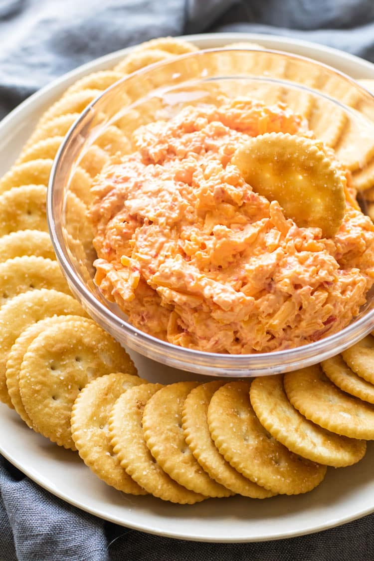 close-up photo of a bowl of pimento cheese with ritz crackers