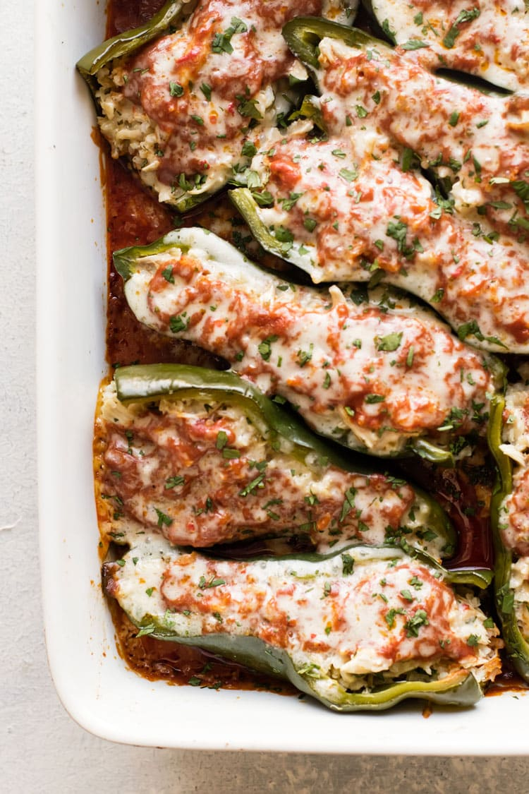 overhead photo of stuffed poblano peppers in a baking dish