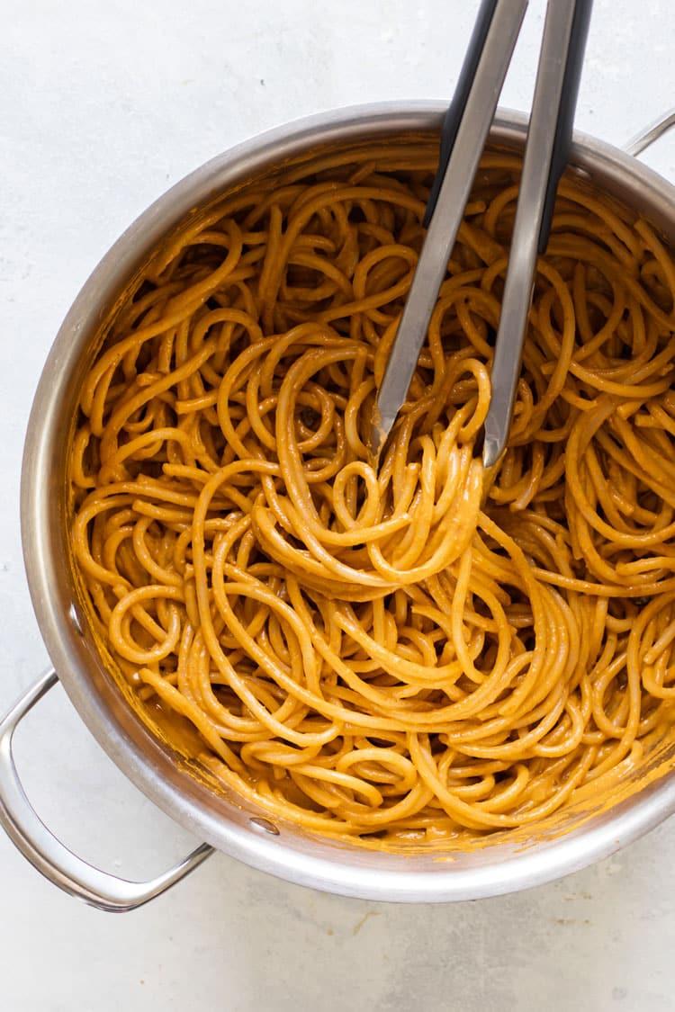 overhead photo of a pot of tomato pasta
