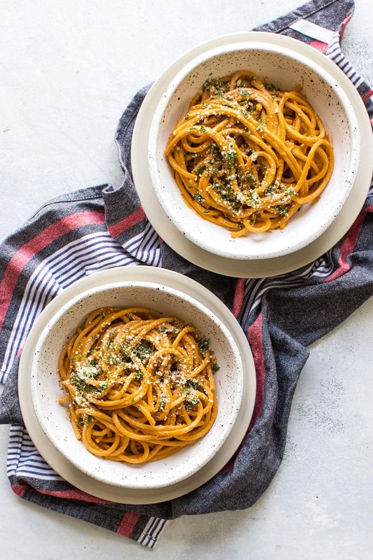 overhead photo of two bowls of tomato pasta