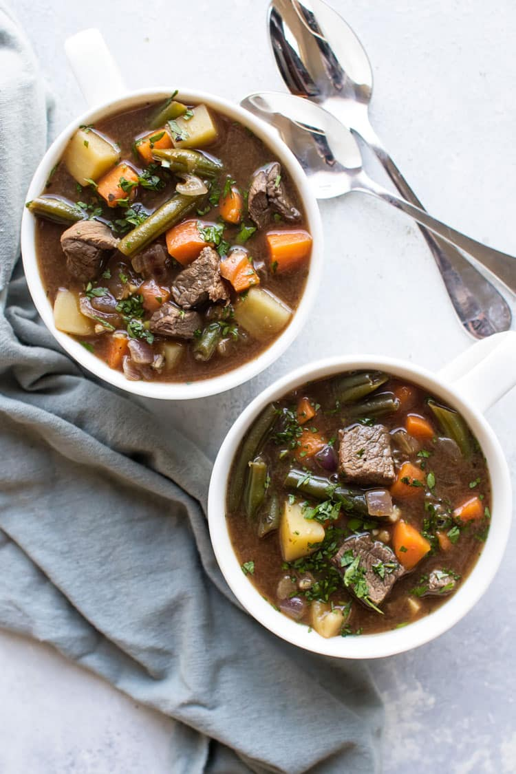 Overhead photo of two bowls of vegetable beef soup