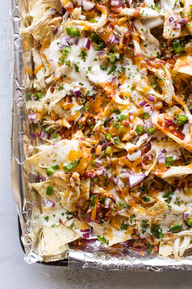 Close-up overhead photo of BBQ chicken nachos on a sheetpan