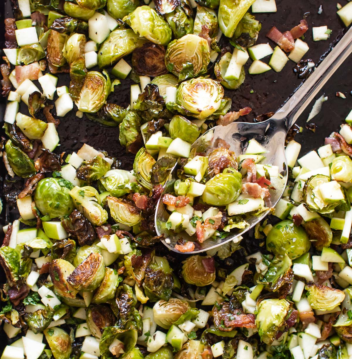 close-up photo of bacon-roasted brussels sprouts with apples