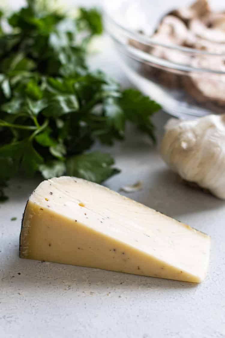 photo of a wedge of truffle cheese
