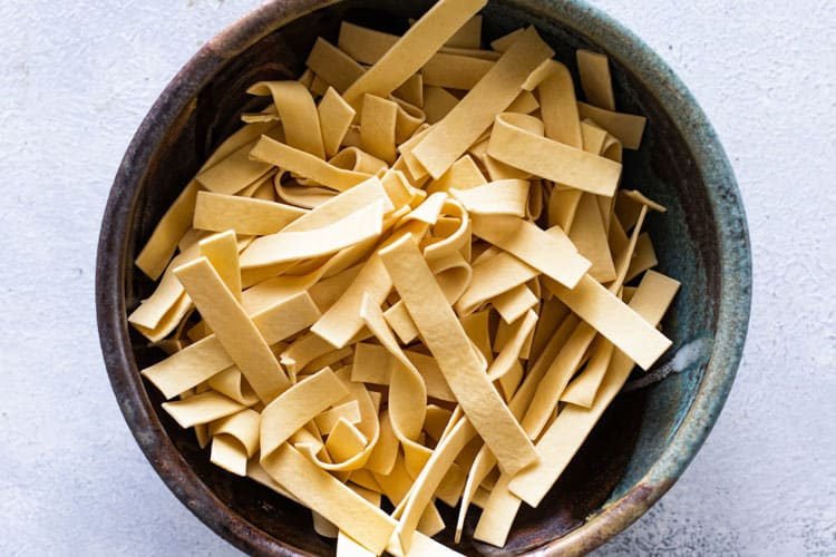 photo of a bowl of dry egg noodles