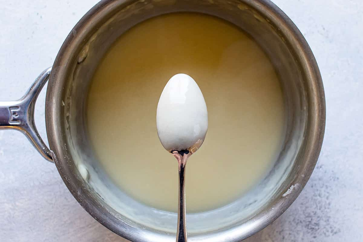 photo of the back of a spoon coated with sauce