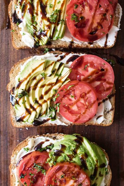 overhead photo of avocado toast with tomatoes and balsamic glaze