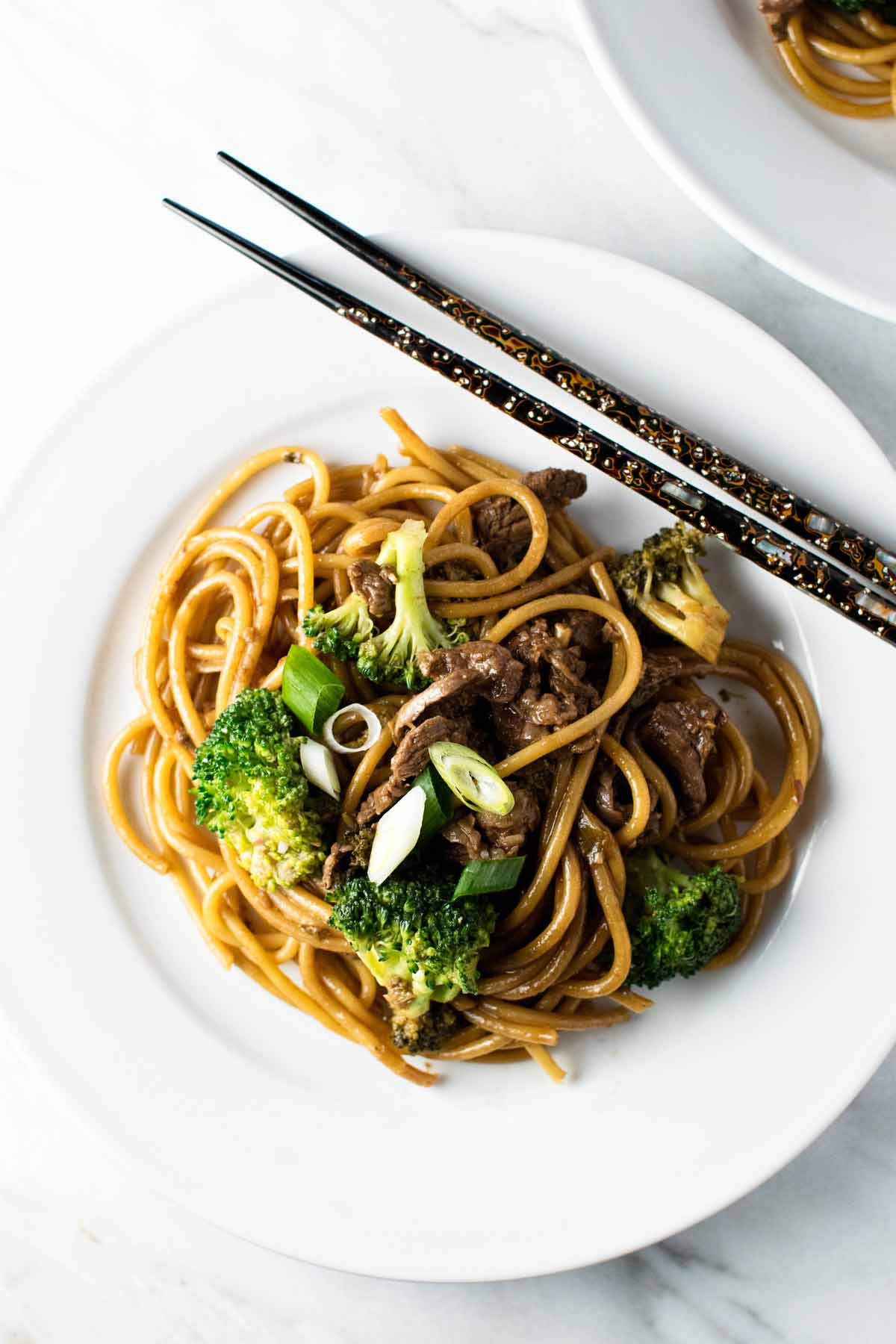 overhead photo of the finished dish on a plate with chopsticks