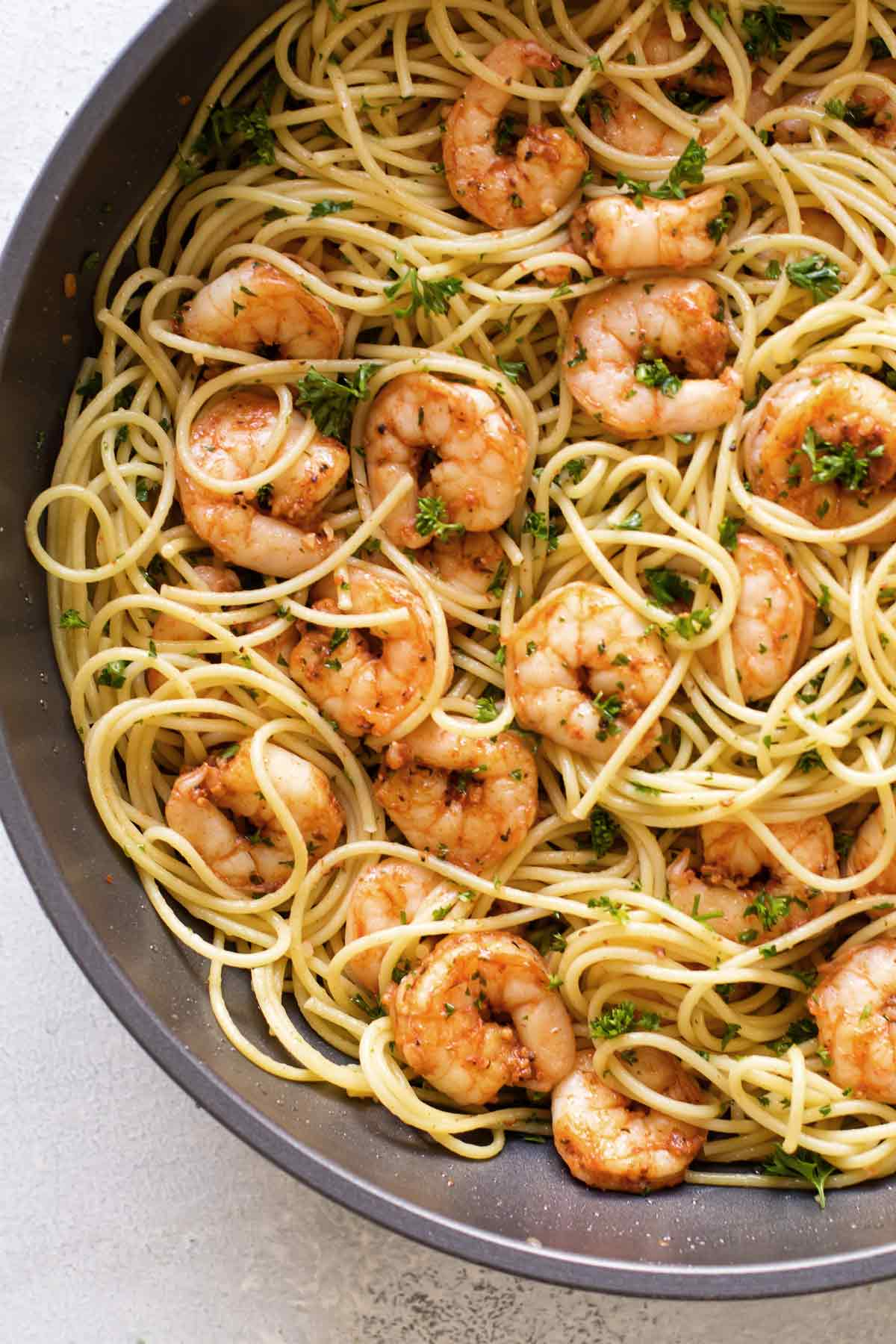 overhead photo of shrimp pasta in a pan