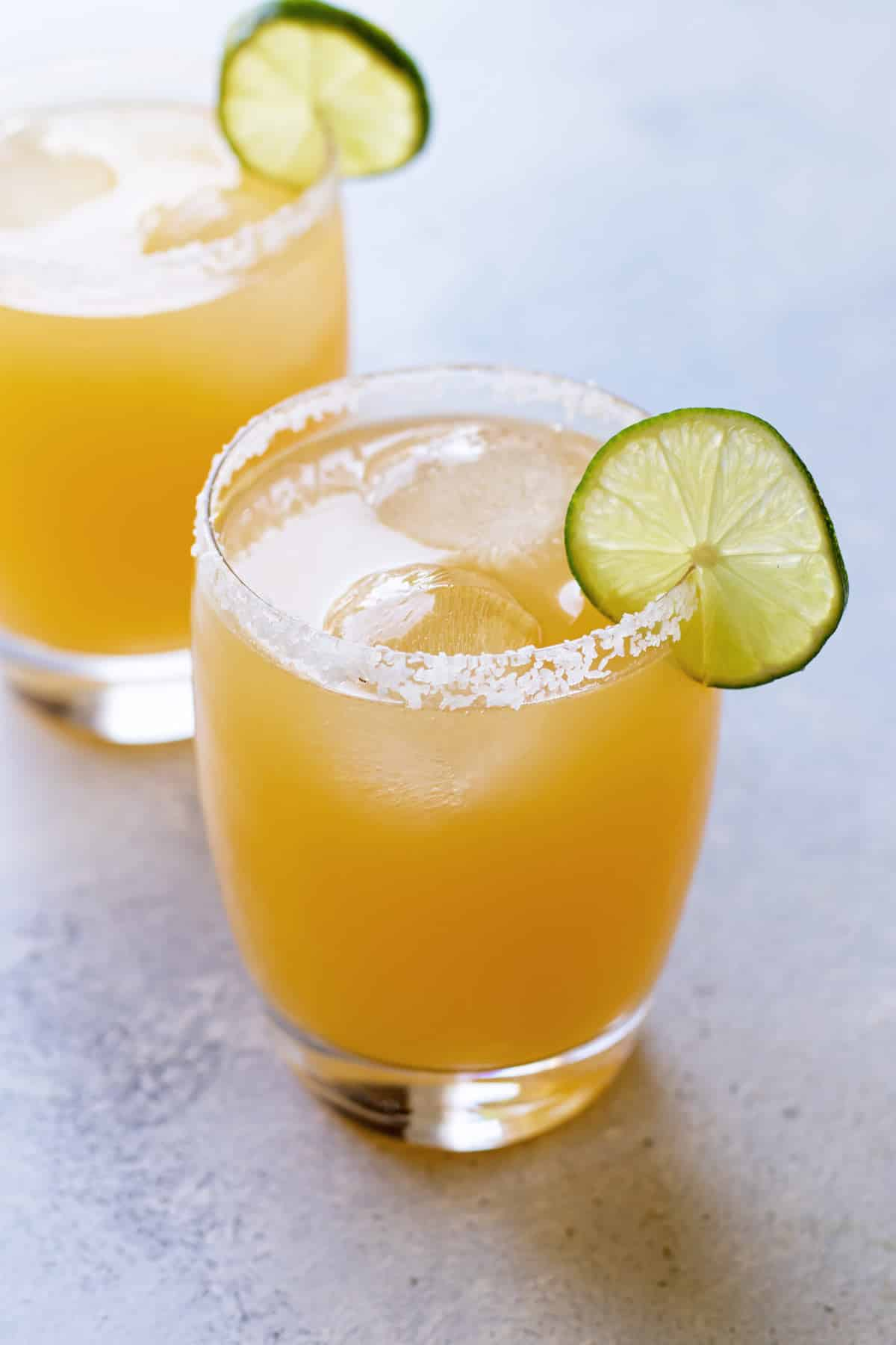 close-up photo of a margarita with a lime garnish