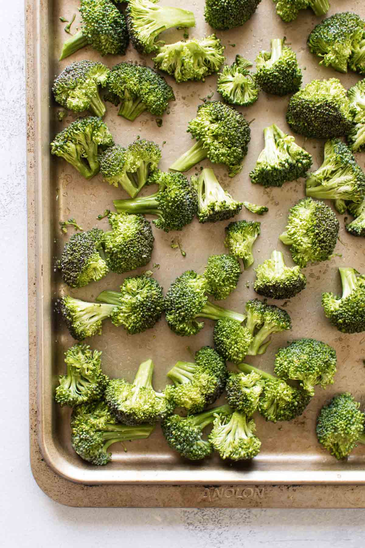 overhead photo of the broccoli on a baking sheet ready to go in the oven