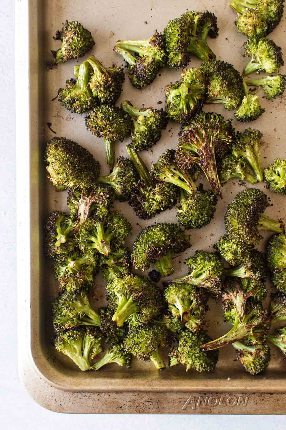 overhead photo of roasted broccoli on a baking sheet