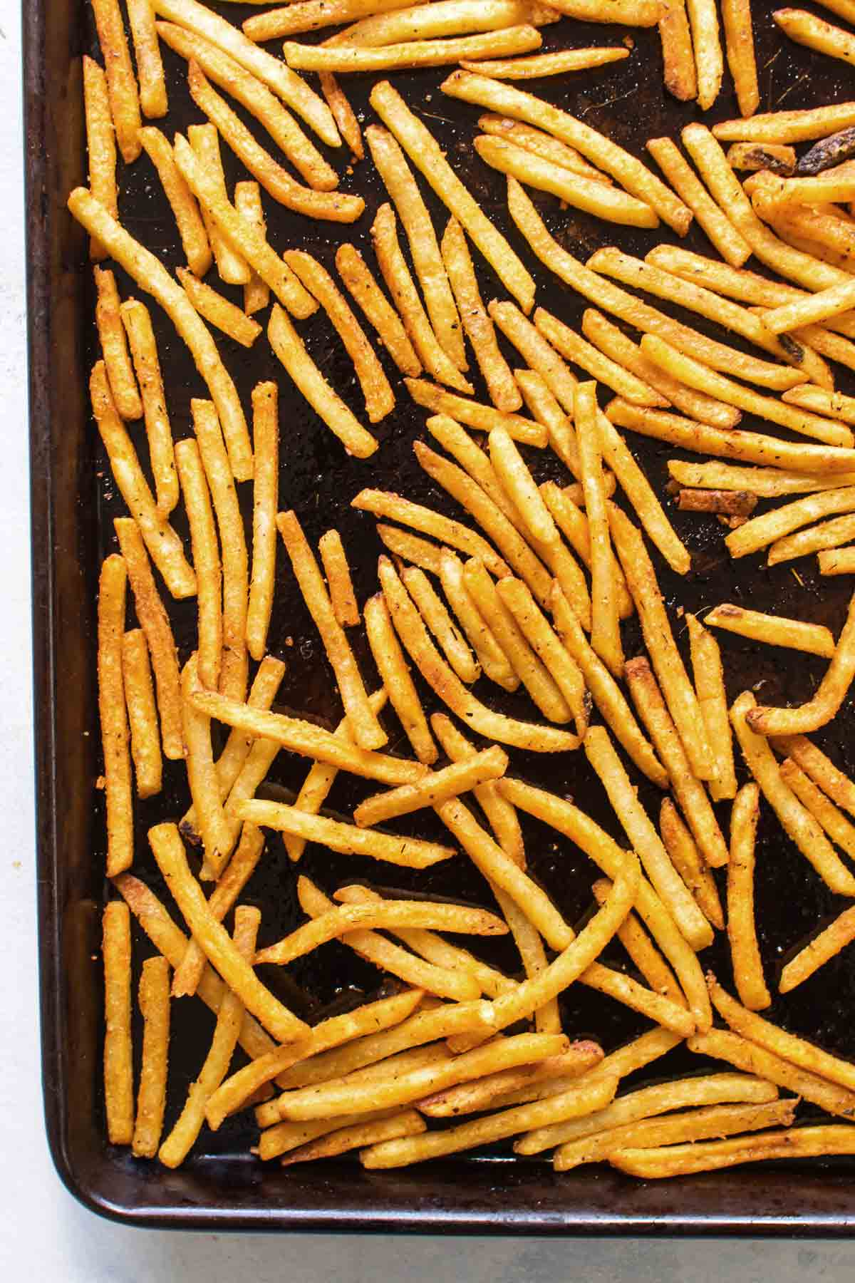 overhead photo of the baked fries on a baking sheet