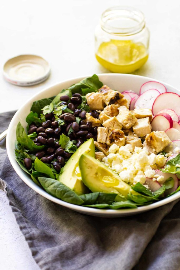 close-up photo of chicken spinach salad