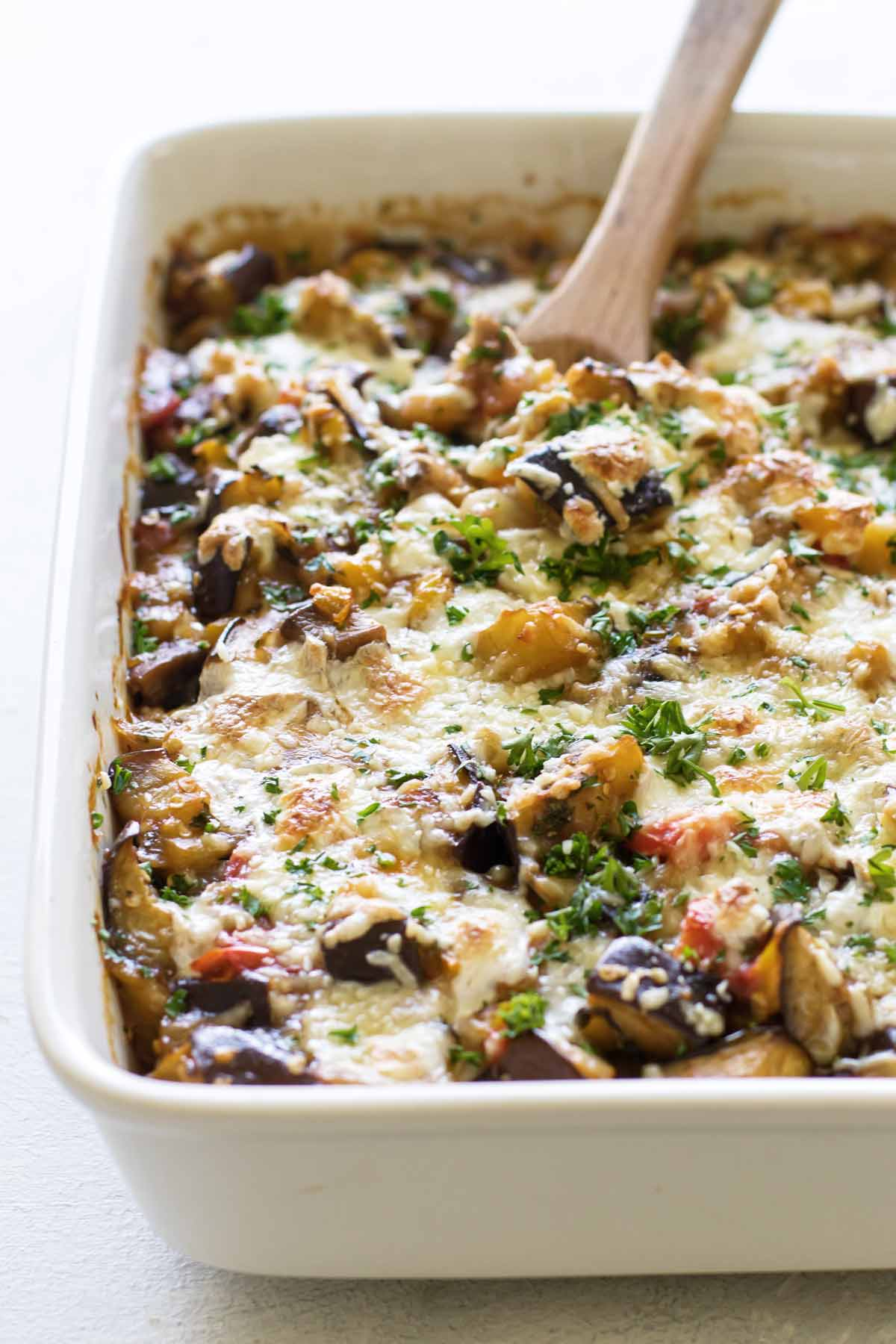 close-up photo of the casserole with a wooden spoon