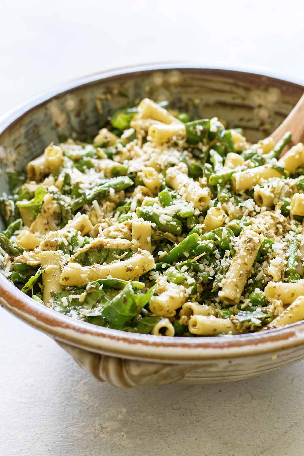close-up photo of pesto pasta salad in a serving bowl