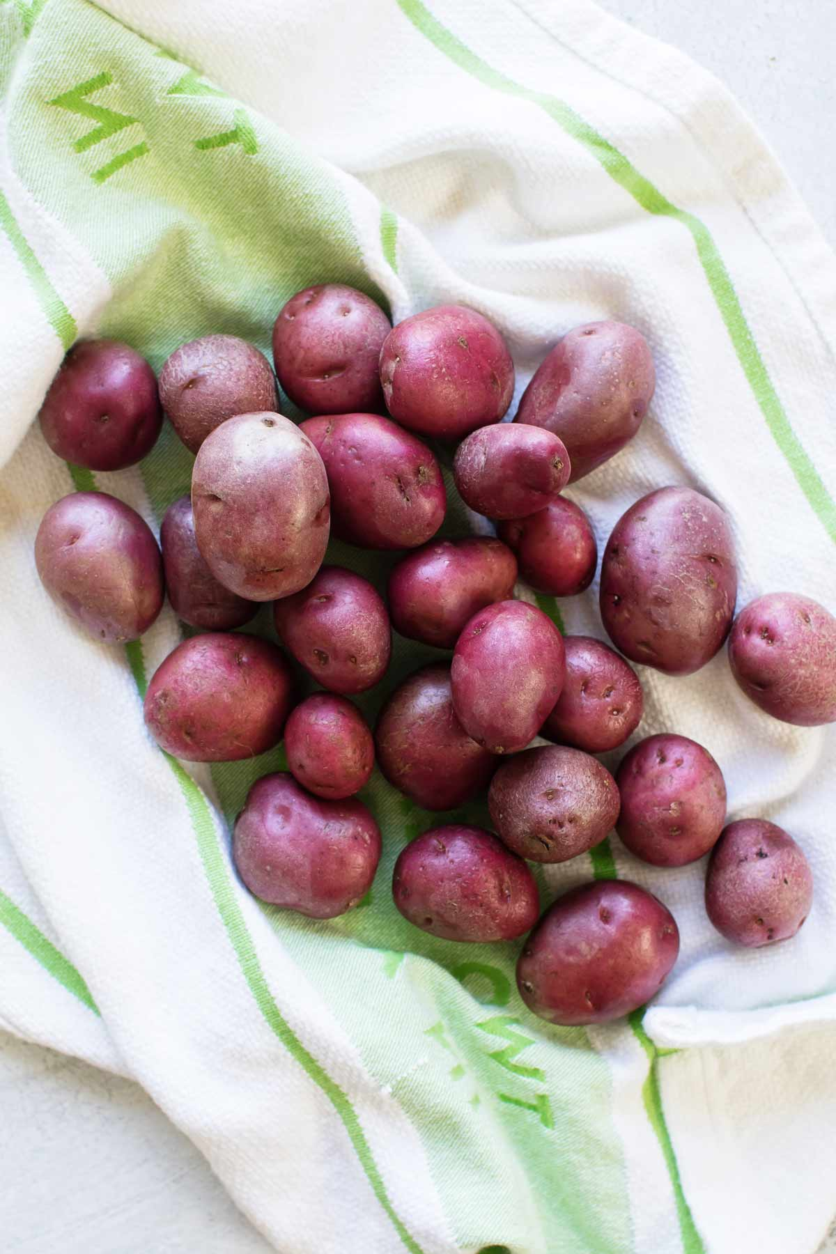 overhead photo of red potatoes on a dish towel
