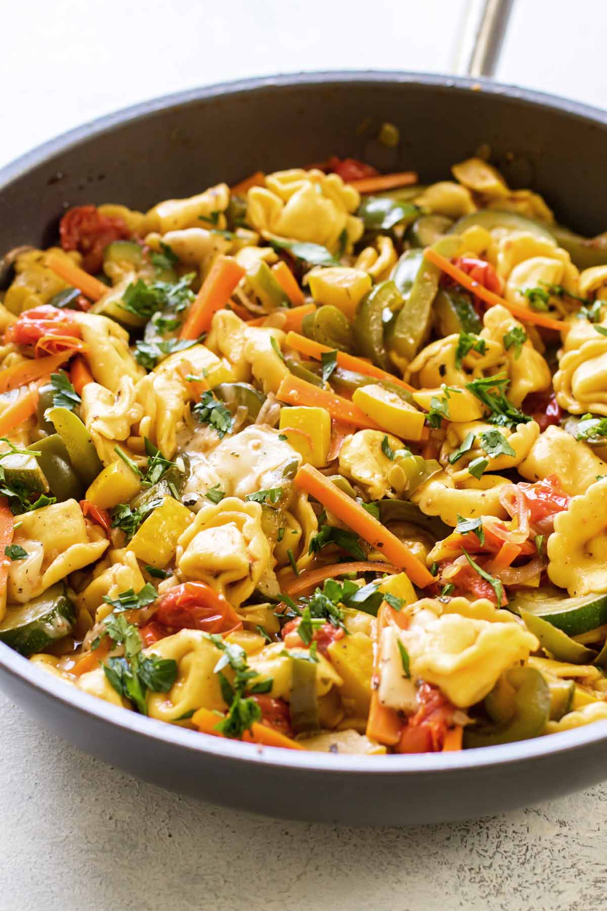 close-up photo of skillet with pasta and vegetables