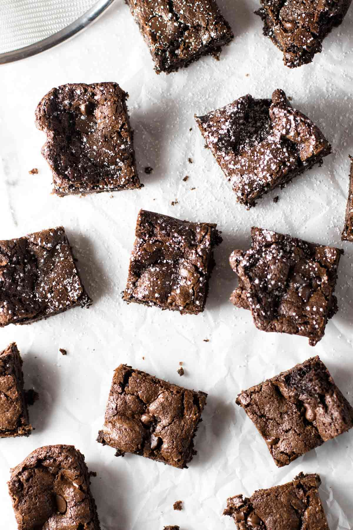 overhead photo of brownies dusted with powdered sugar
