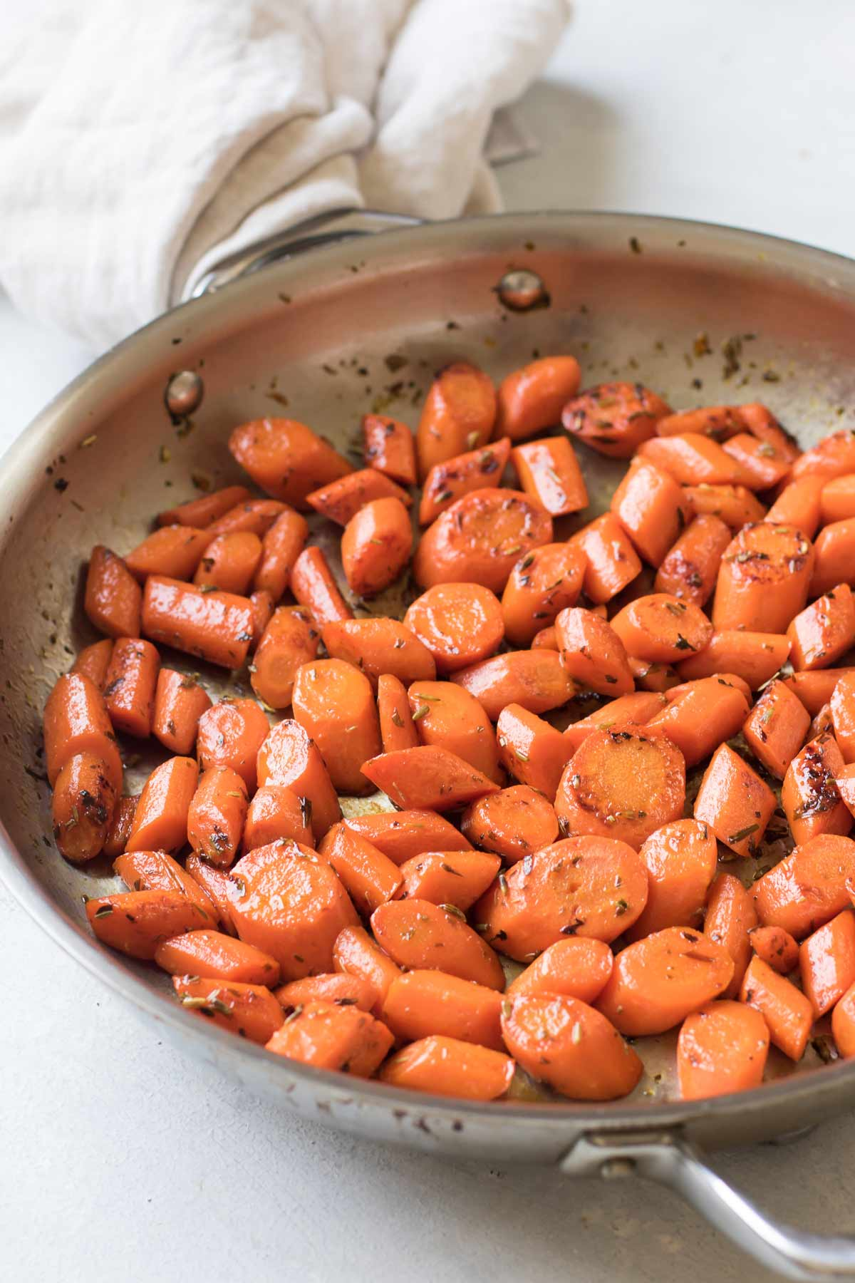 cooked carrots in a skillet.
