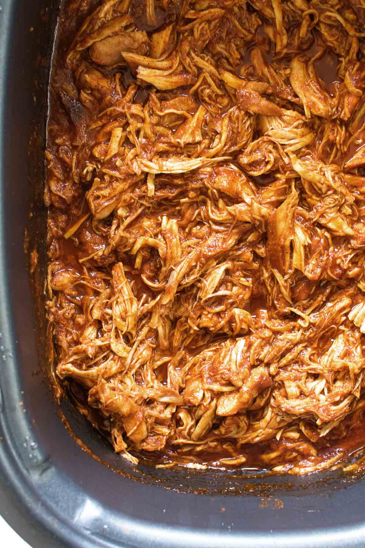 shredded bbq chicken in a slow cooker.