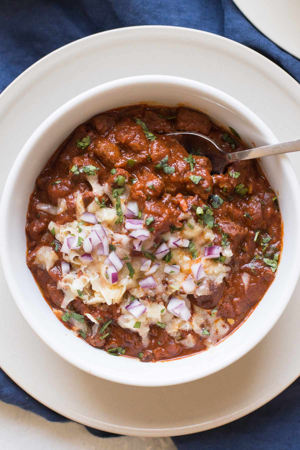 bowl of Texas chili with toppings