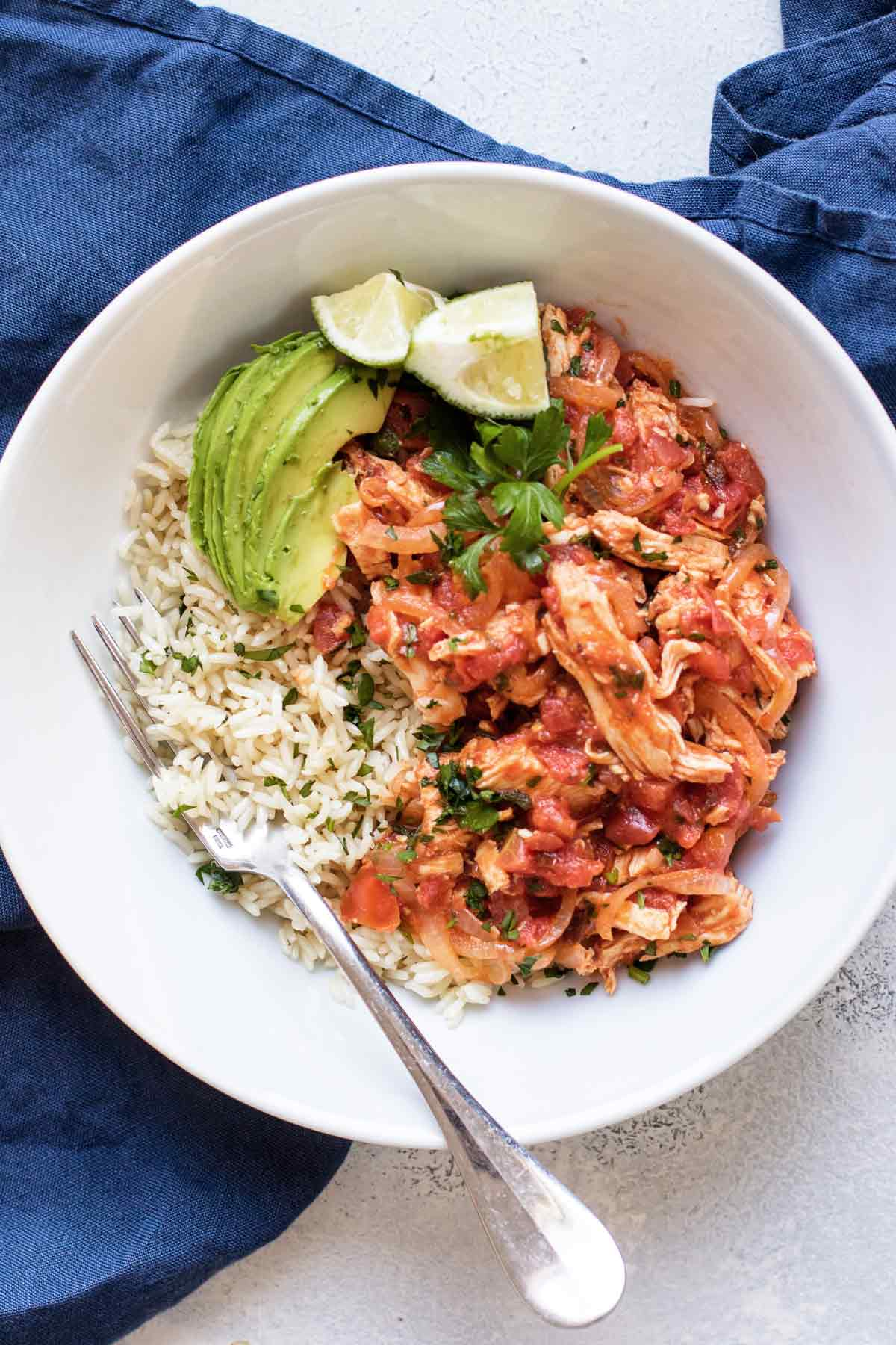 chicken tinga in a bowl with rice