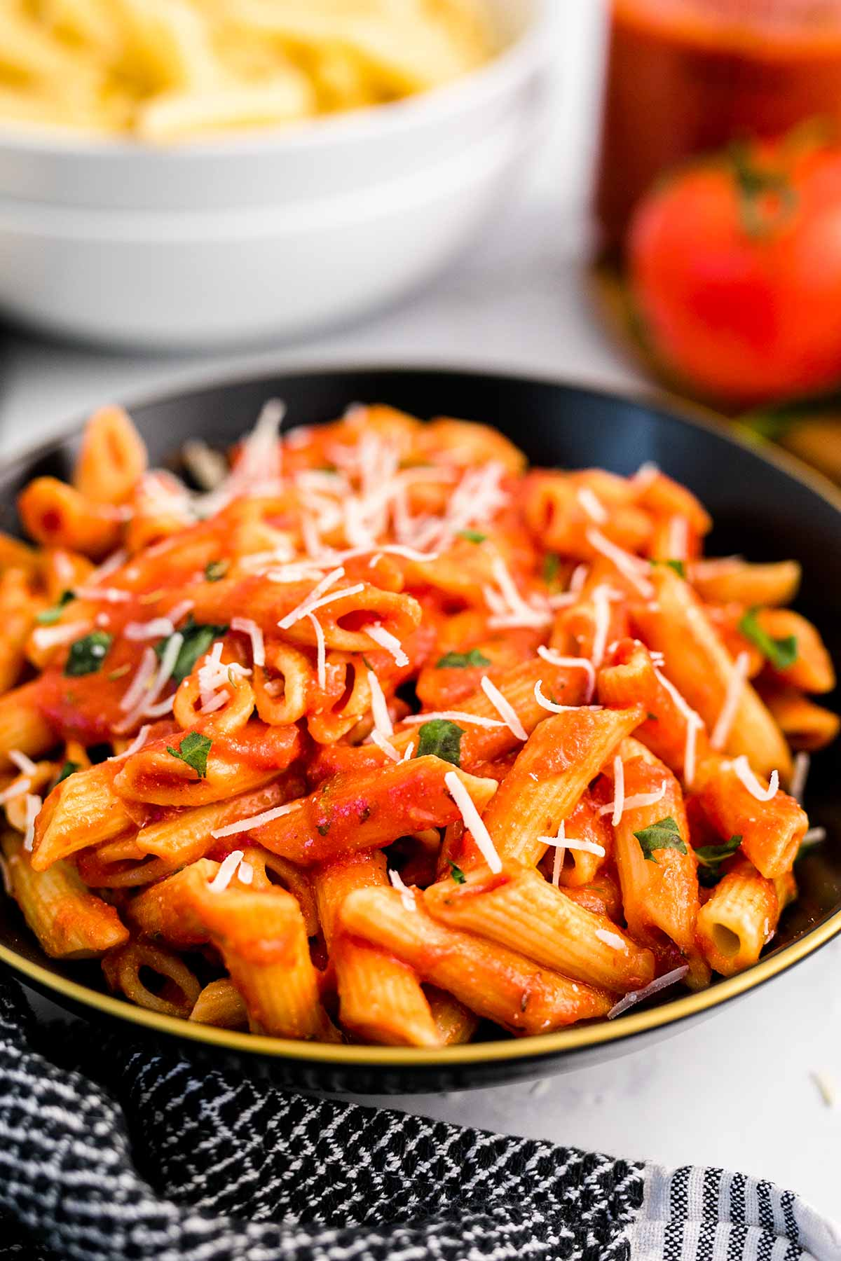 a bowl of penne pasta with pasta sauce