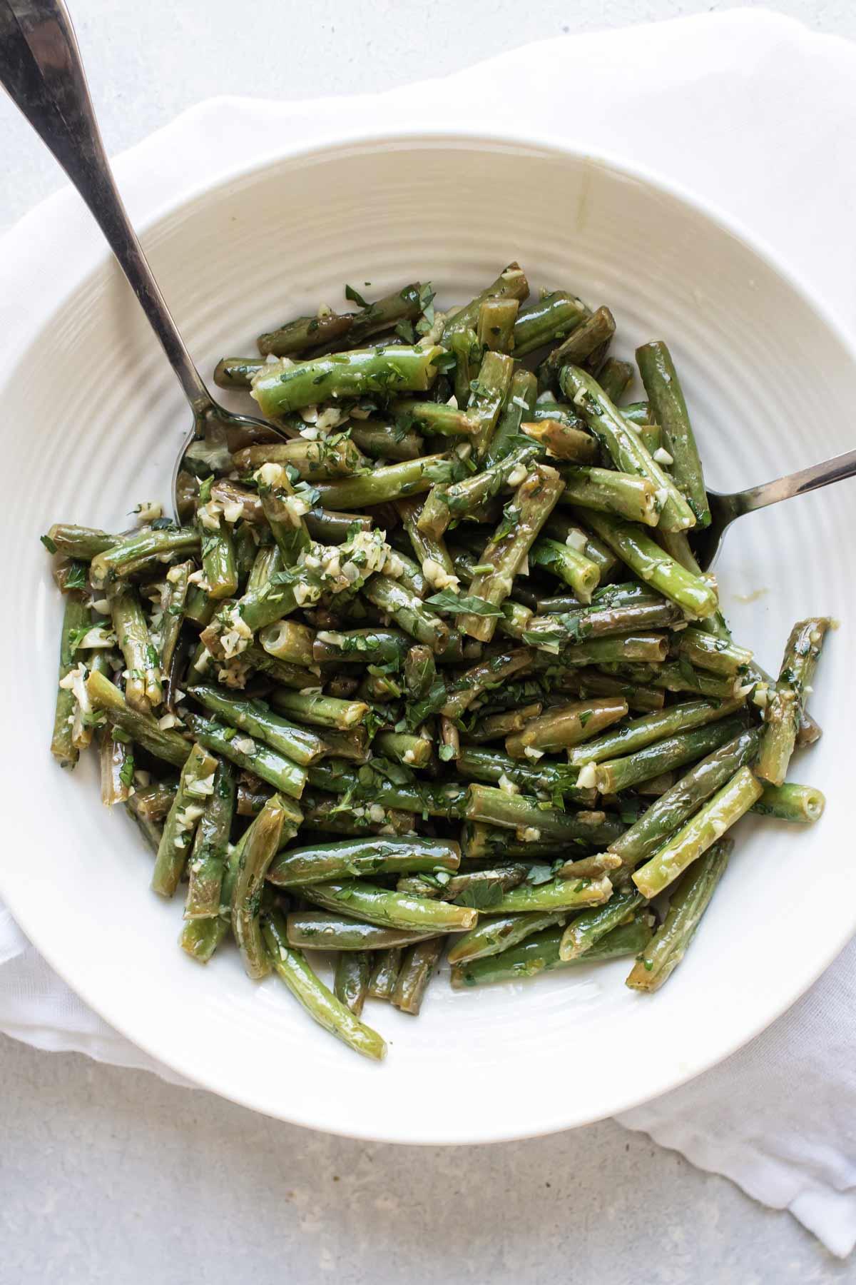 a bowl of garlic butter green beans