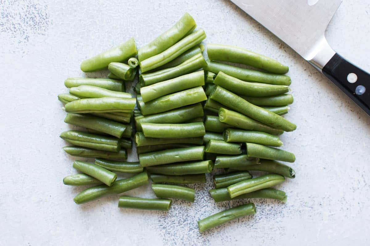 a bunch of green beans cut into thirds.