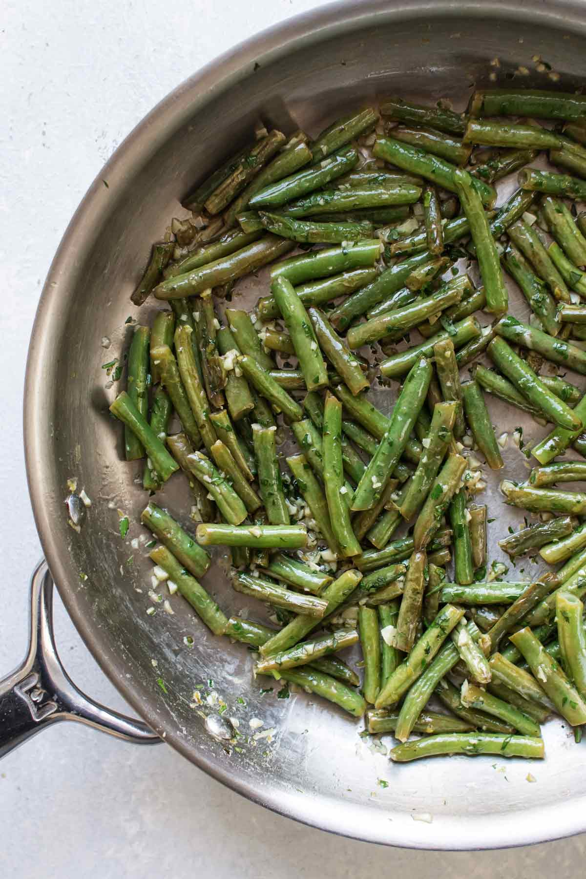 the finished green beans in a skillet