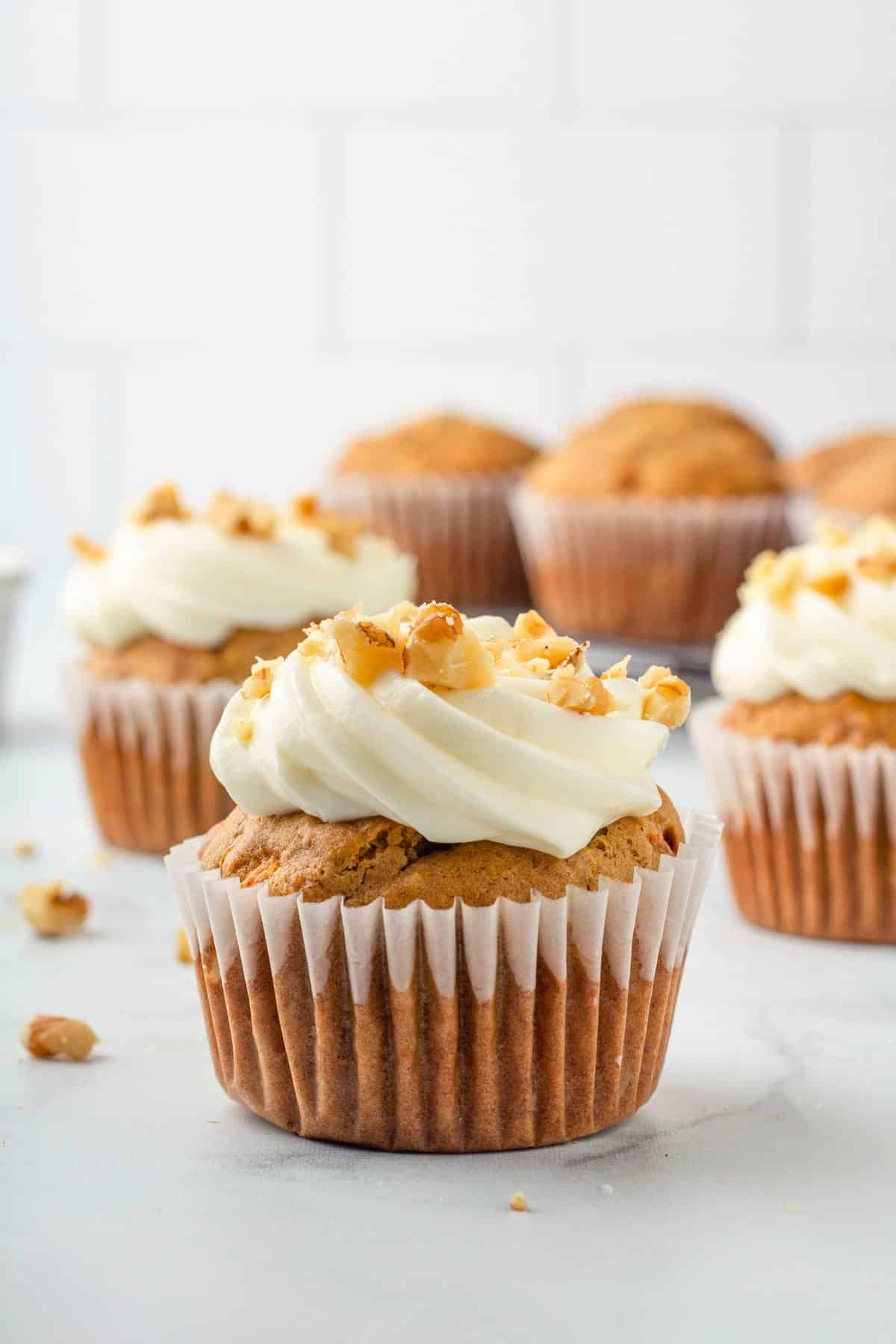 carrot cake cupcake with frosting.