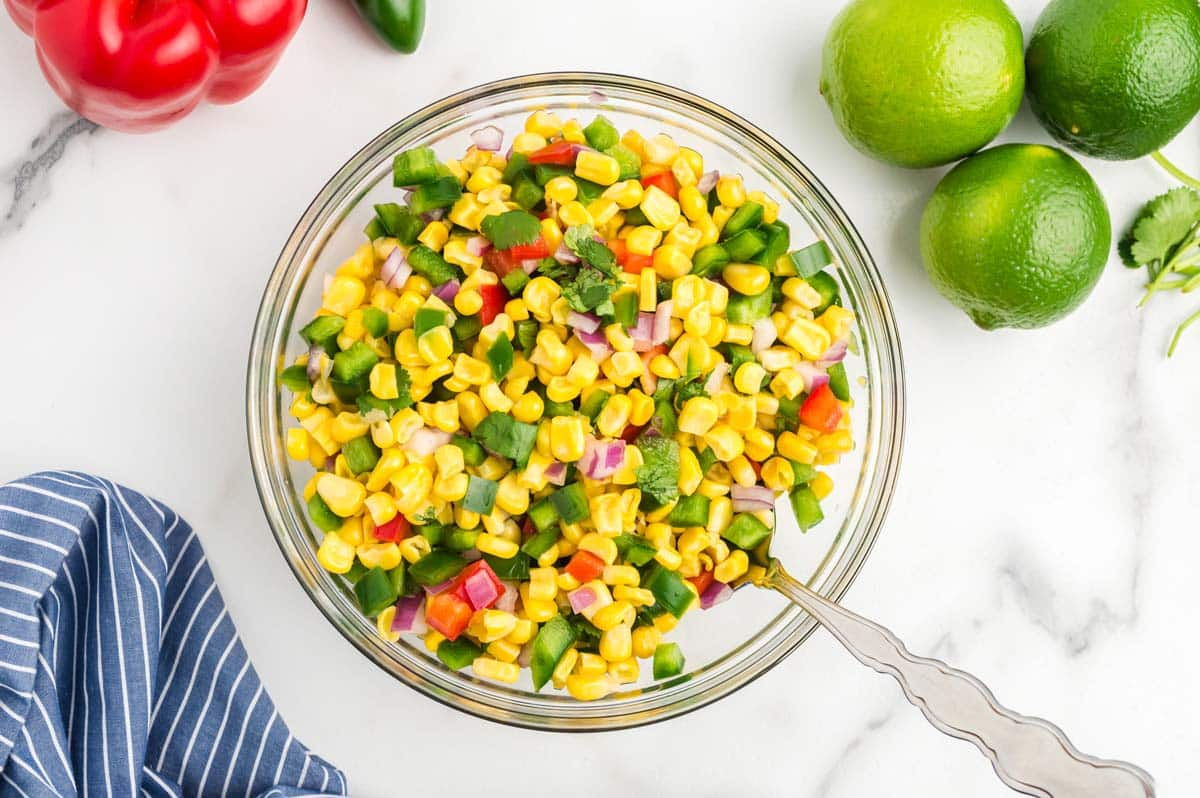 a bowl of corn salsa mixed and ready to serve.
