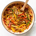 peppers and sausage pasta in a pan.