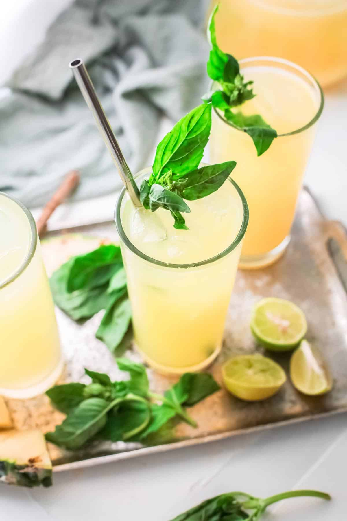 glasses of pineapple agua fresca garnished with fresh mint.