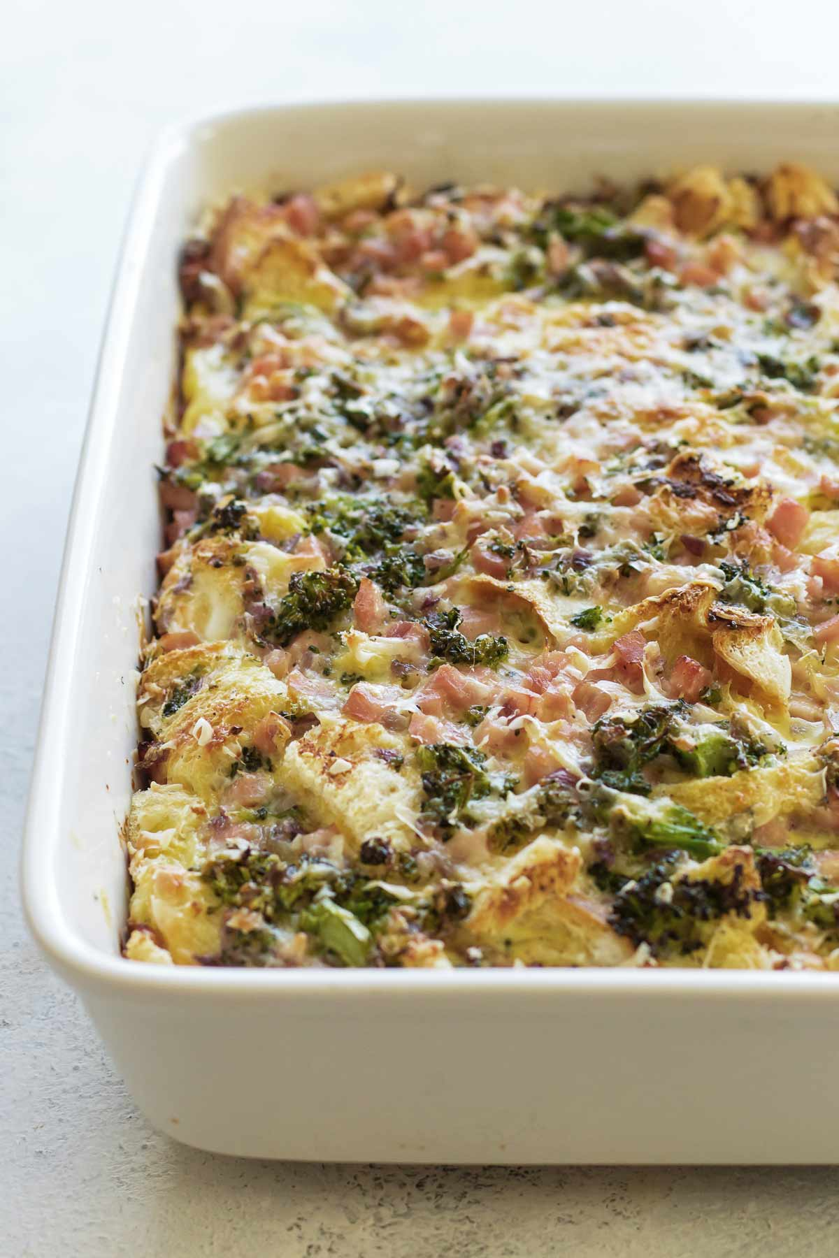 a ham and broccoli strata in a baking dish.