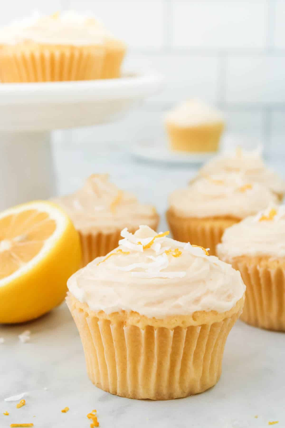lemon cupcakes with coconut frosting.