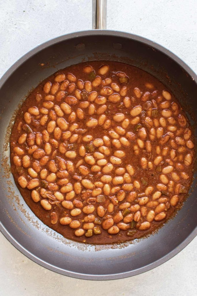 beans and picante sauce simmering in a skillet.