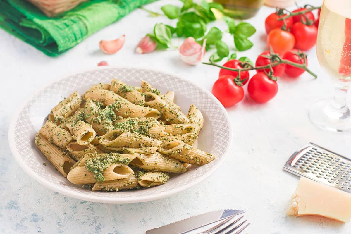 pasta coated in pesto in a bowl.