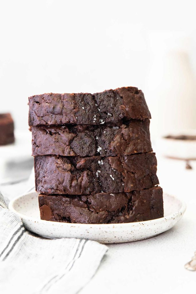 slices of chocolate zucchini bread on a plate.
