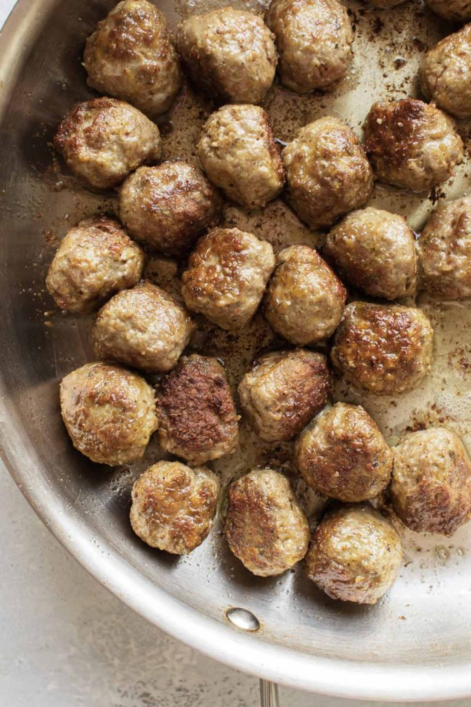 cooked meatballs in a skillet.