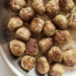 meatballs in a pan with text overlay.