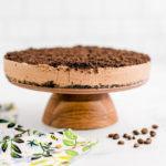 mocha cheesecake on a cake stand.