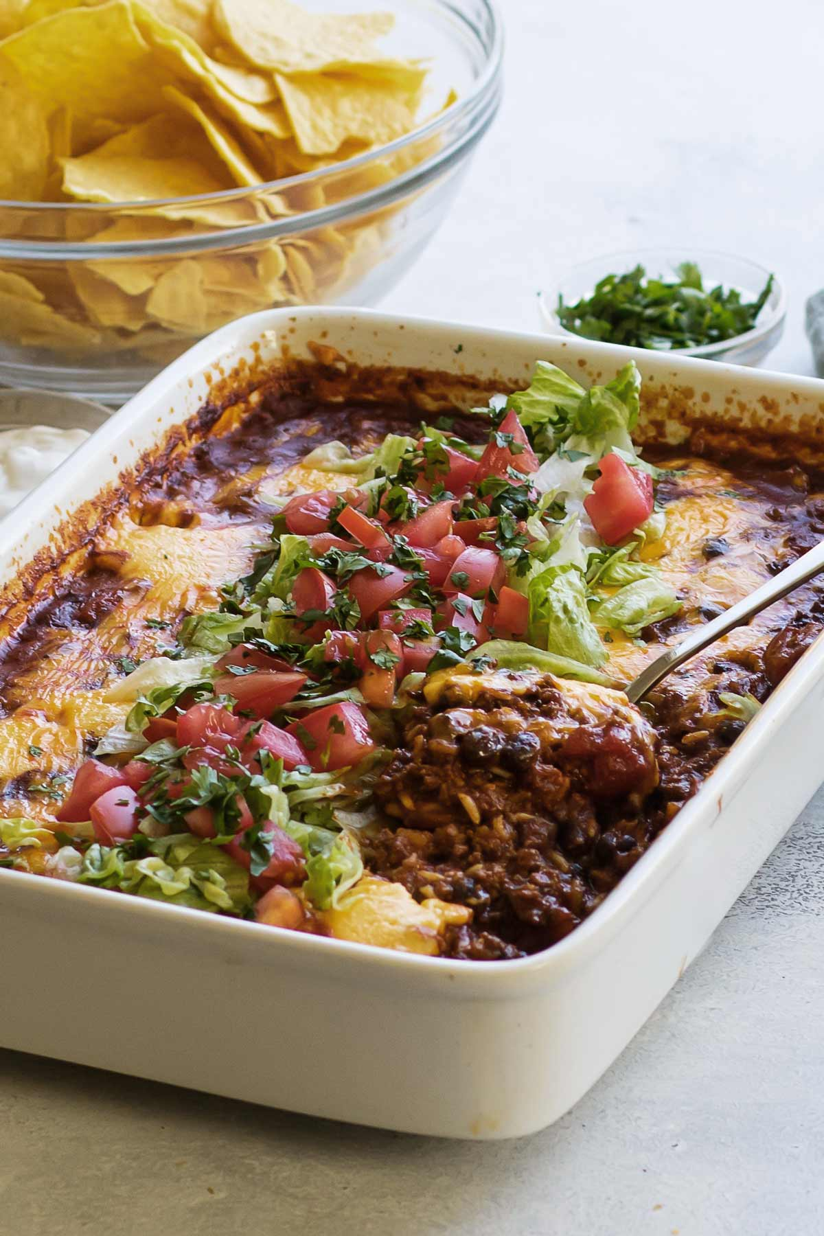 taco rice casserole with a serving spoon.
