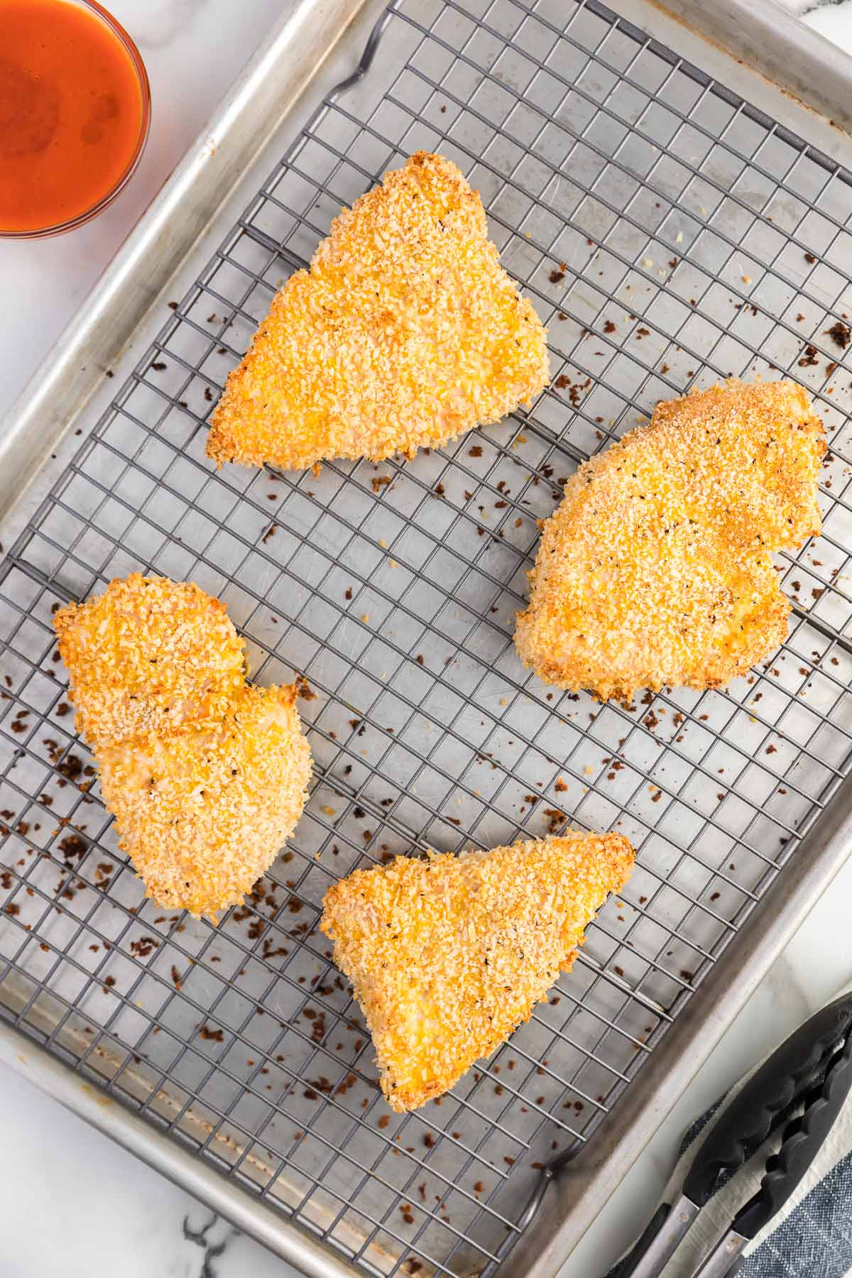 baked breaded chicken on a rack.