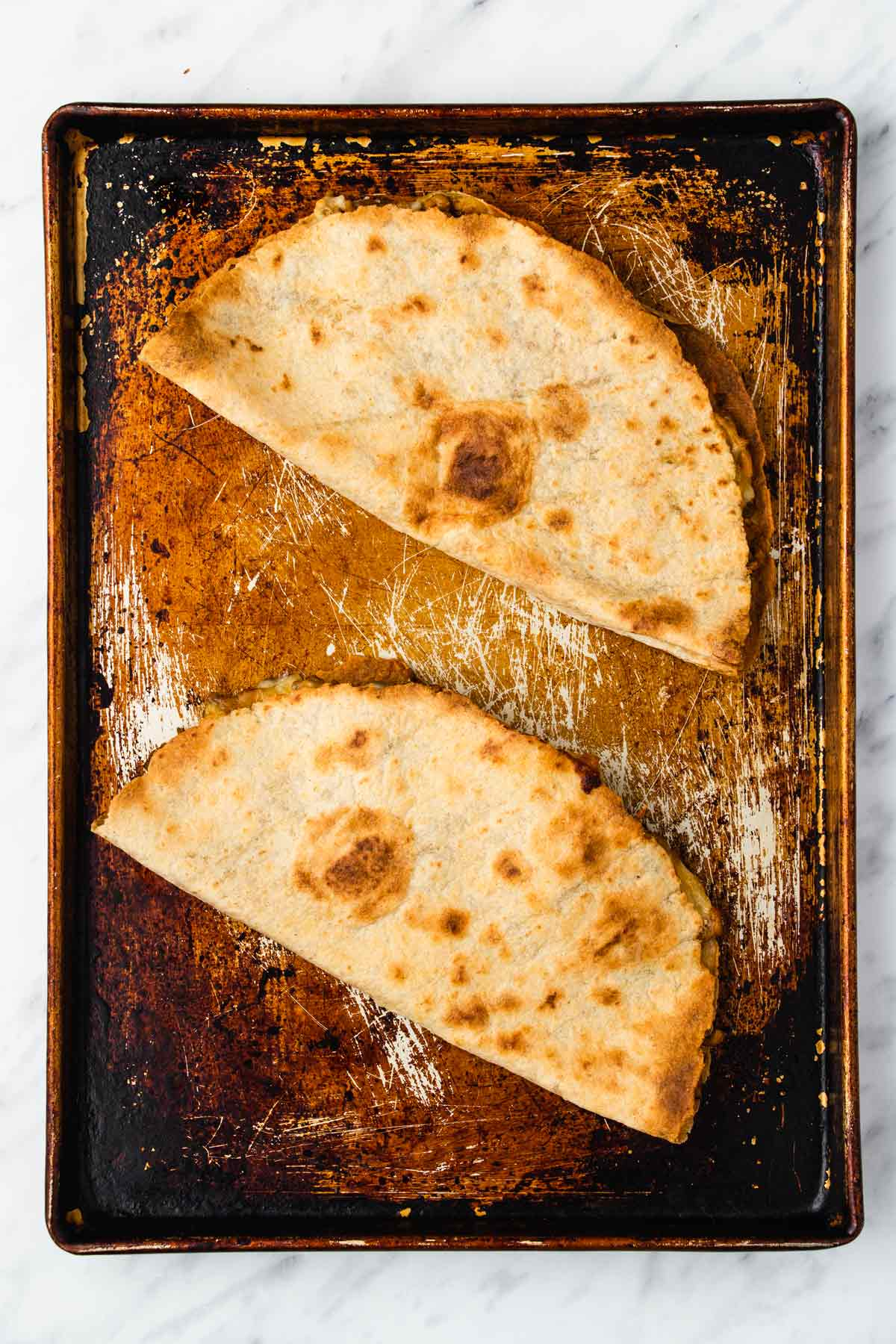 two cooked quesadillas.