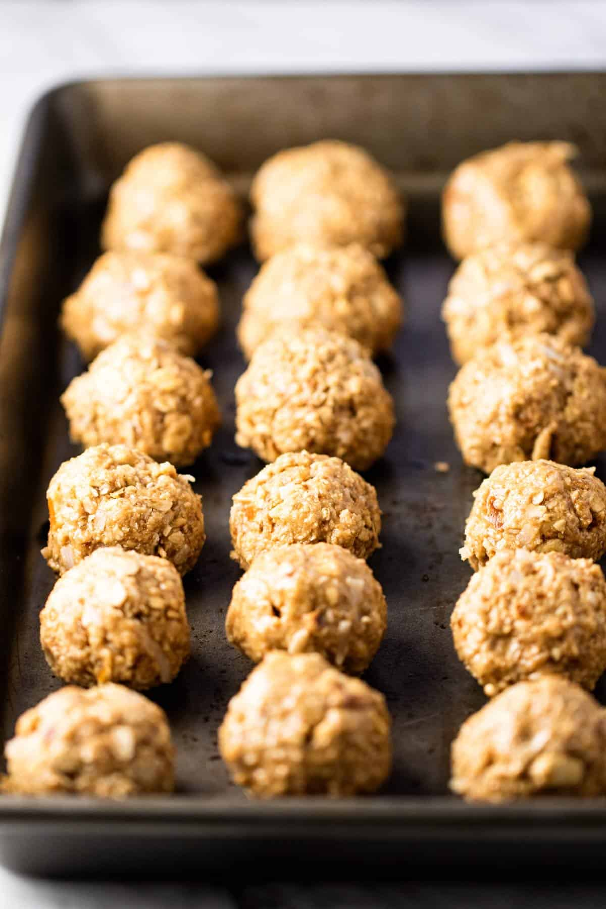 oatmeal balls on a baking sheet.
