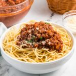 a bowl of pasta with bolognese.